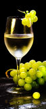 Wine glass with grapes bunch Royalty Free Stock Photo