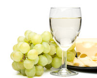 Wine in a glass, grapes and cheese Stock Image