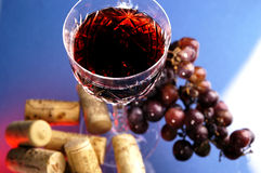 Wine glass, grapes and corks Stock Images
