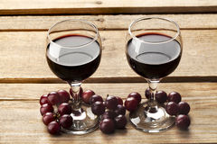 Wine glass and grapes Stock Photography
