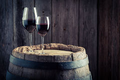 Wine in glass with grapes on old barrel. Wine in glass with grapes on old wooden barrel Royalty Free Stock Photography