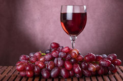 Wine glass and grapes Royalty Free Stock Images