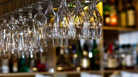 Wine glass hanging oh shelf in pub & restaurant royalty free stock photos
