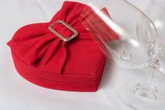 Wine glass and heart shaped box stock photo