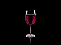 Wine. Glass of wine isolated on a black background Royalty Free Stock Photo