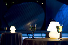 Wine glass and lamp. Romantic evening in restaurant with white wine and lamp stock images