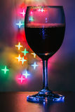 Wine glass with a light  shaped bokeh Stock Images