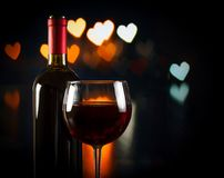 Wine glass near bottle, concept of valentine's day Stock Photo