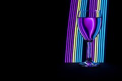 Wine glass with neon light behind royalty free stock images