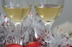 Wine in the glass with New Year decoration Royalty Free Stock Photo