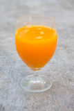 Wine glass of orange juice Stock Images
