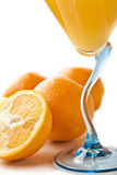 Wine glass with orange juice and fruit Stock Images