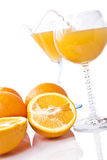 Wine glass with orange juice and fruit Royalty Free Stock Photo