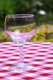Wine glass outdoors. Photograph of an empty wine glass outdoors Royalty Free Stock Images