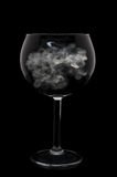 Wine Glass over black with Smoke in Bowl Royalty Free Stock Image