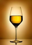 Wine glass  over gold background Stock Photos