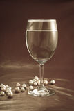 Wine glass and pearls Royalty Free Stock Photo