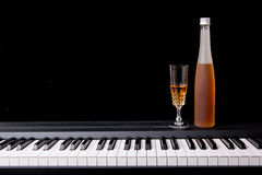 Wine glass on piano Stock Image