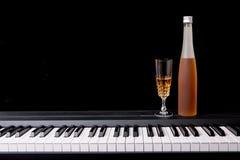 Wine glass on piano Stock Image