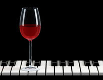 Wine glass on piano key Stock Image