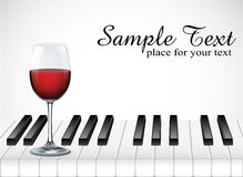Wine glass and piano key on white background Stock Photo