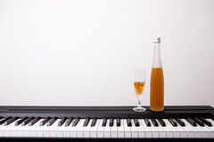 Wine glass on piano Royalty Free Stock Photo
