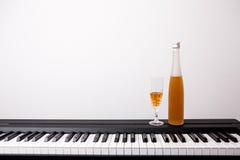 Wine glass on piano Royalty Free Stock Photo