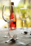 Wine glass and place setting in a restaurant Royalty Free Stock Photography