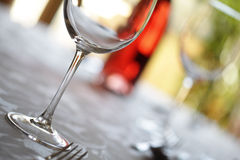 Wine glass and place setting in a restaurant Royalty Free Stock Photo