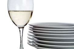 Wine glass and plates royalty free stock photos