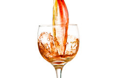 Wine and a glass pouring, white background Stock Photo