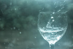 Wine glass in the rain Royalty Free Stock Image