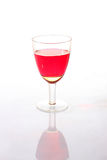 Wine-glass with a red drink Stock Image