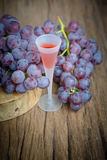 Wine glass and red grape Stock Photography