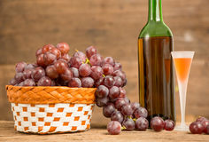 Wine glass and red grape Stock Image