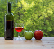 Wine glass red and green apple on table Stock Photos