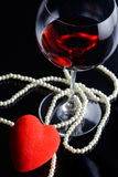 Wine glass and a red heart Stock Photos