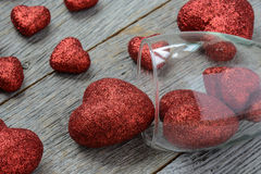 Wine Glass with Red Hearts Stock Images