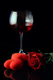 Wine glass and red rose stock photos