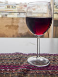 Wine. A glass of red wine sits on a a table overlooking a window Stock Photos