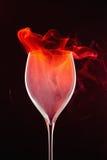 Wine Glass. With red smoke on dark background Stock Photo