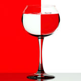 Wine glass on red and white Royalty Free Stock Photography