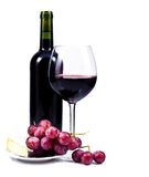 Wine glass with red wine and bottle of wine. Wine glass with red wine, bottle of wine and grapes isolated over white background stock photography