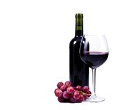 Wine glass with red wine and bottle of wine. Wine glass with red wine, bottle of wine and grapes isolated over white background Stock Photo