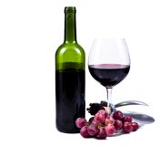 Wine glass with red wine and bottle of wine. Wine glass with red wine, bottle of wine and grapes isolated over white background Stock Image