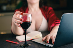 Wine glass with red wine and laptop computer Stock Photos