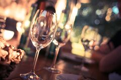 Wine Glass on Restaurant Table Stock Images