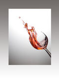 Wine glass with rose splash in frame Stock Image