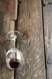 Wine glass on rustic wooden tabletop Stock Image