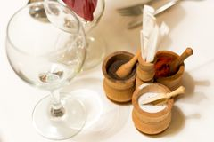 Wine glass and salt/pepper cellars royalty free stock photography